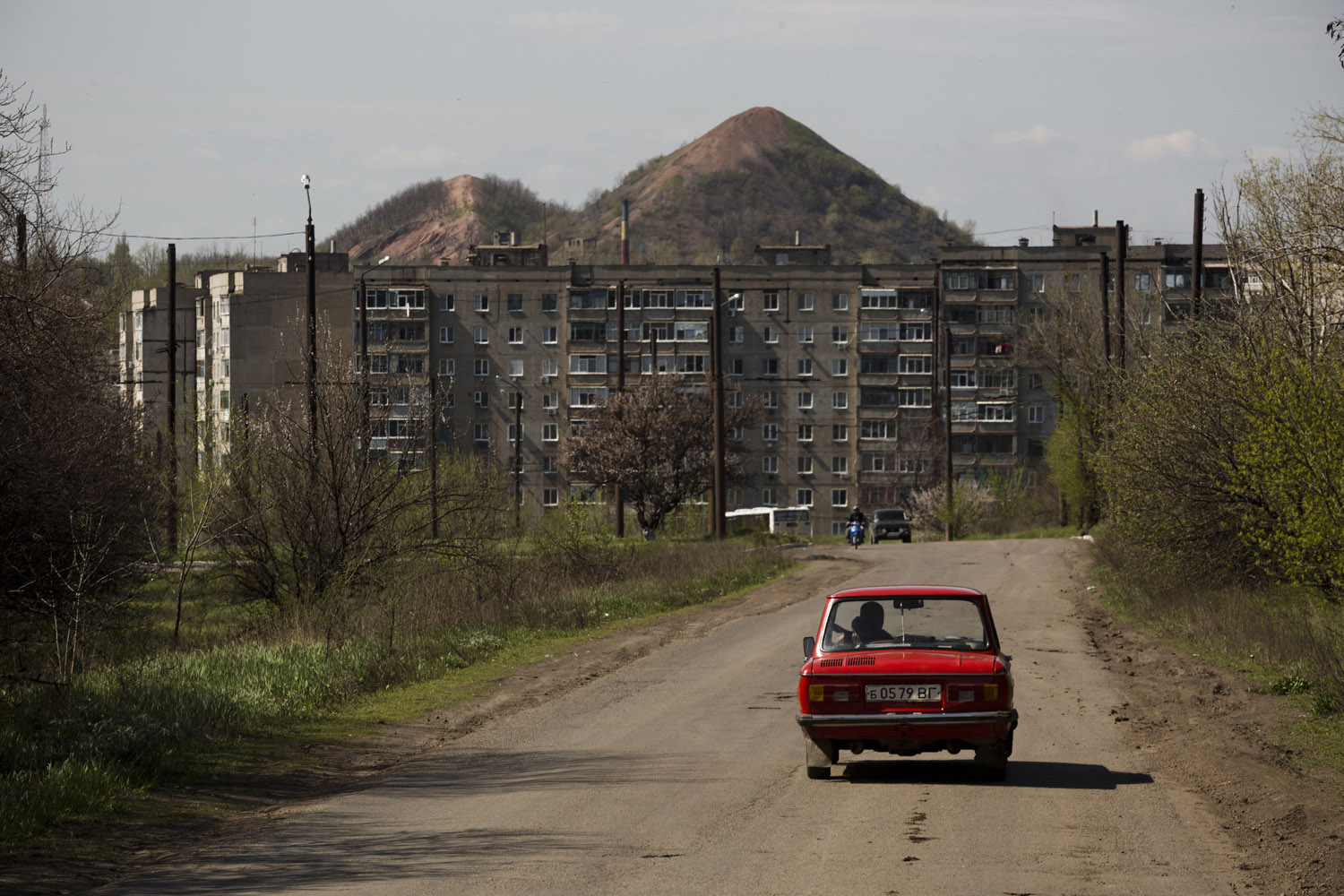 "Krasnodon, a mining town some 5 km from the Russian border. On the background is the defining feature of the Donbass' landscape: the ""terrikon"", a mound of debris excavated by a mine."