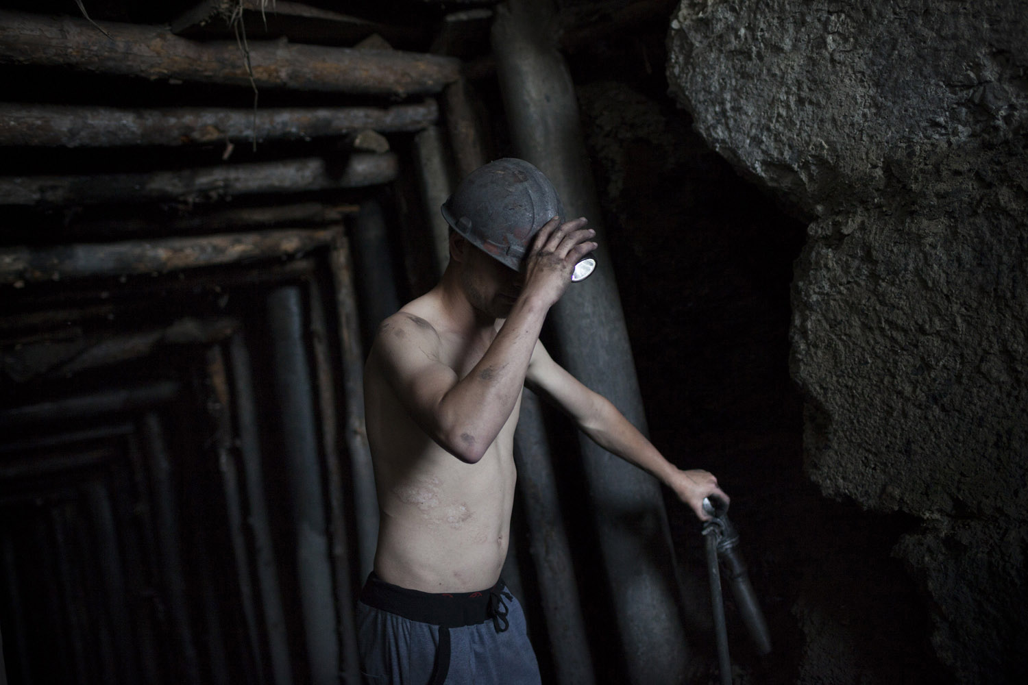 A young miner coming out of an illegal mine near Shakhtiorsk. The mine is not operating at full capacity after water begun leaking into the tunnels, making work extremely dangerous. Illegal mines are mostly owned by local criminals who simply took over what in theory is a national resource.