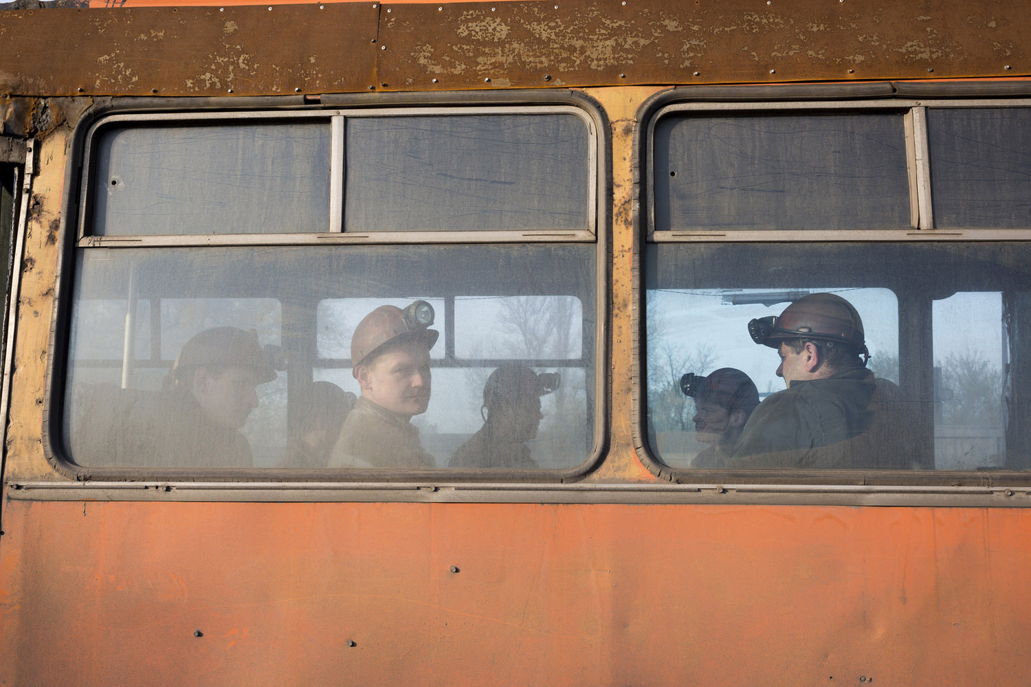 Miners on the bus to work in the early hours of the morning in Makeevka, a mining town on the outskirts of Donetsk.