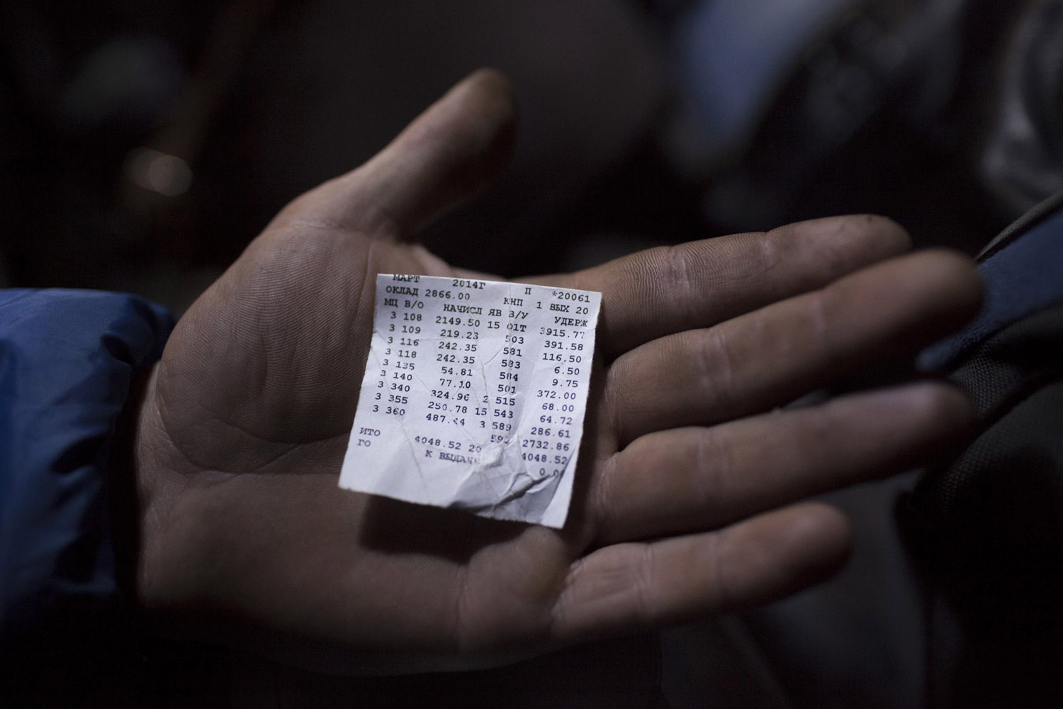 A miner in Krasnodon showing his last monthly paycheck, amounting to little more than 4,000 grivnas, or about 250 euros. The cost of feeding a family can reach 5,000 grivnas, and life keeps getting more expensive, especially since the events at Maidan have thrown the country into turmoil.