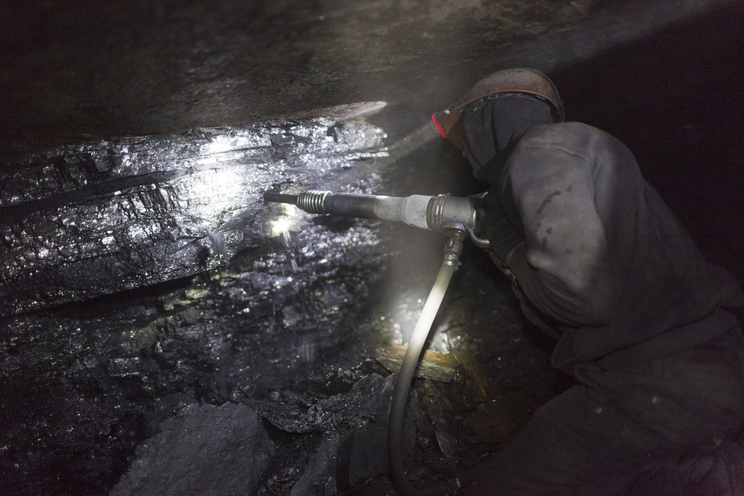 Tolek (23), working several hundred meters underground in an illegal mine in Davidovka.