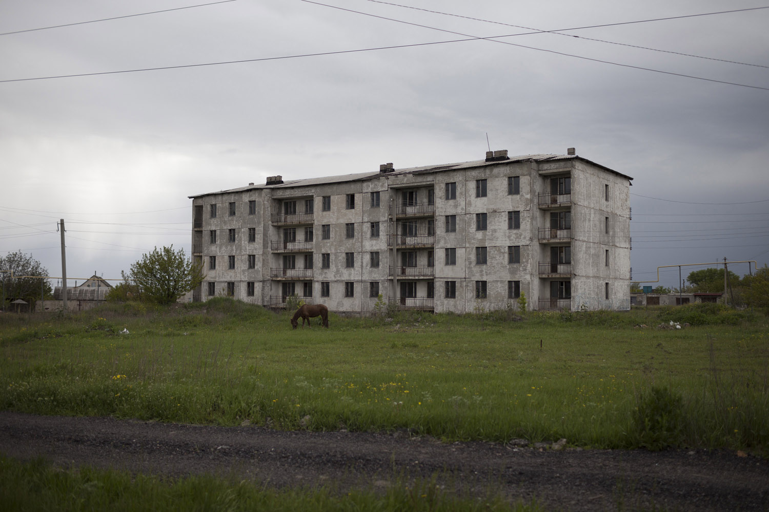 "An apartment complex on the outskirts of Shakhtiorsk, whose name itself is a reference to the ""shakhta"", the mines which employ the overwhelming majority of the town's men."