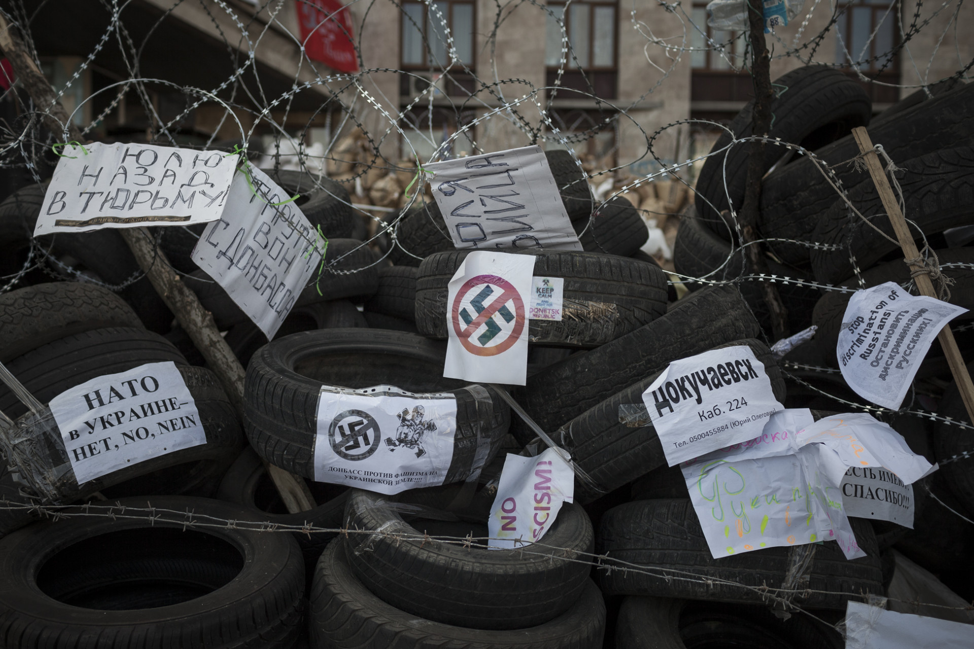 Anti-fascist signs on the barricades outside the occupied regional administration building, the headquarters of the Donetsk People's Republic.