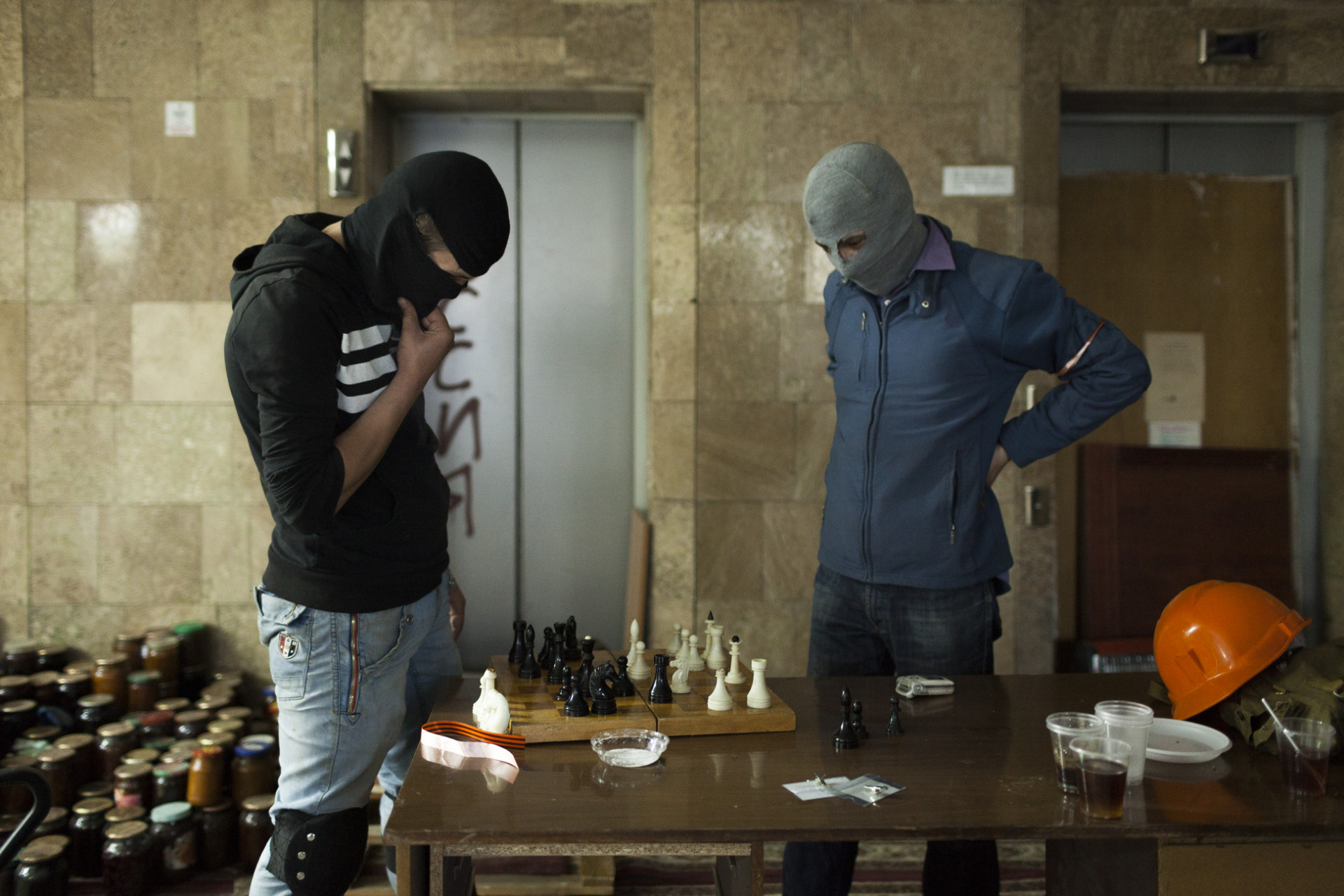 Activists enjoy a quick game of chess inside the occupied Rada.