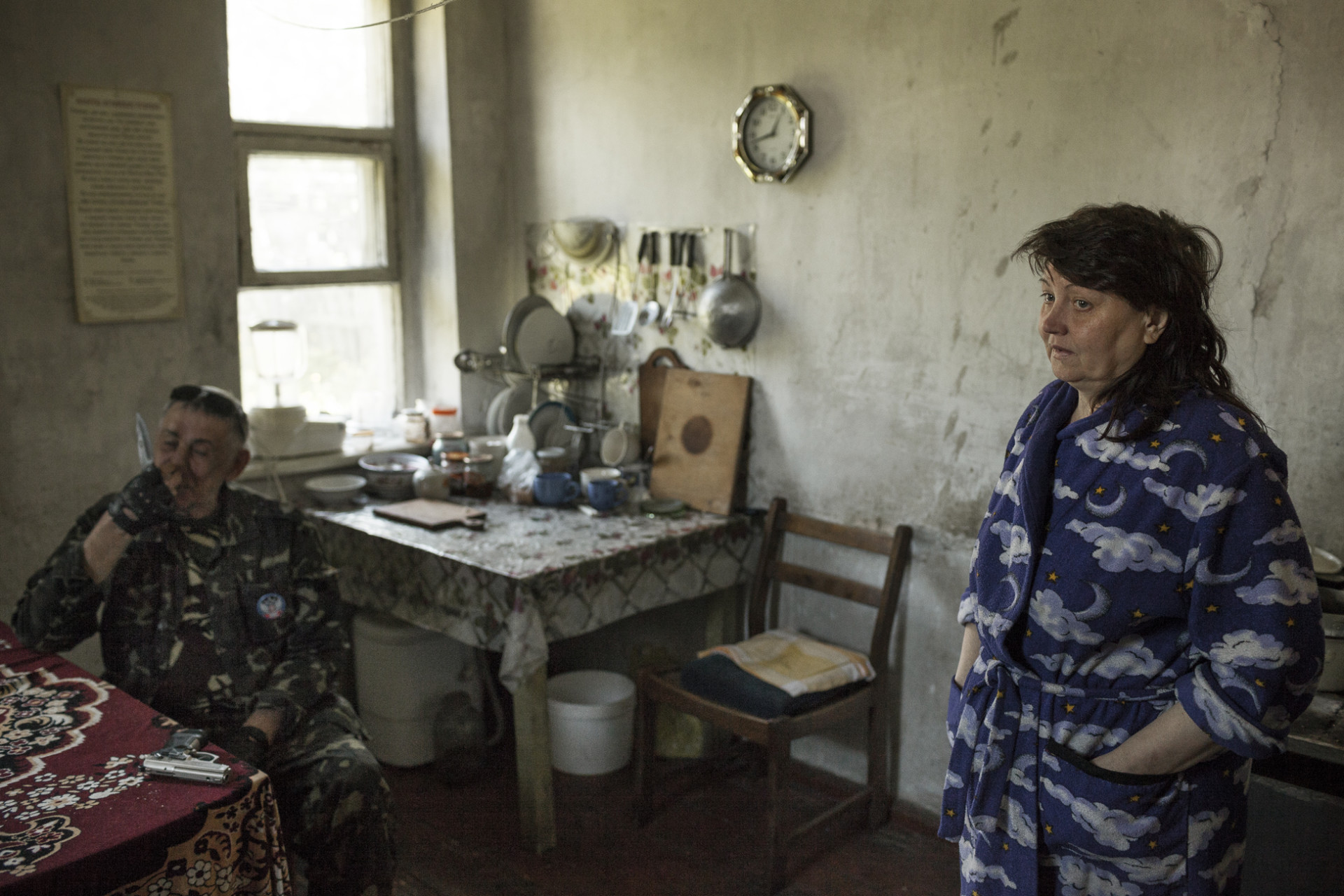 Gennady, a former Red Army spetznatz (special forces soldier) who was in charge of security at the occupied Rada, with his wife at their house on the outskirts of Donetsk.