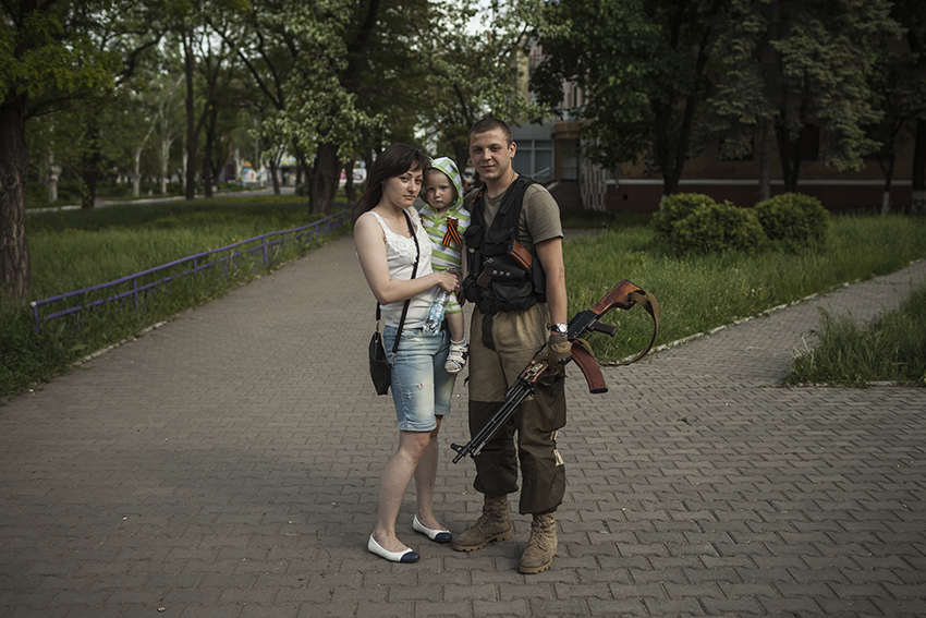 A pro-Russian militiamen with his family in Kramatorsk.