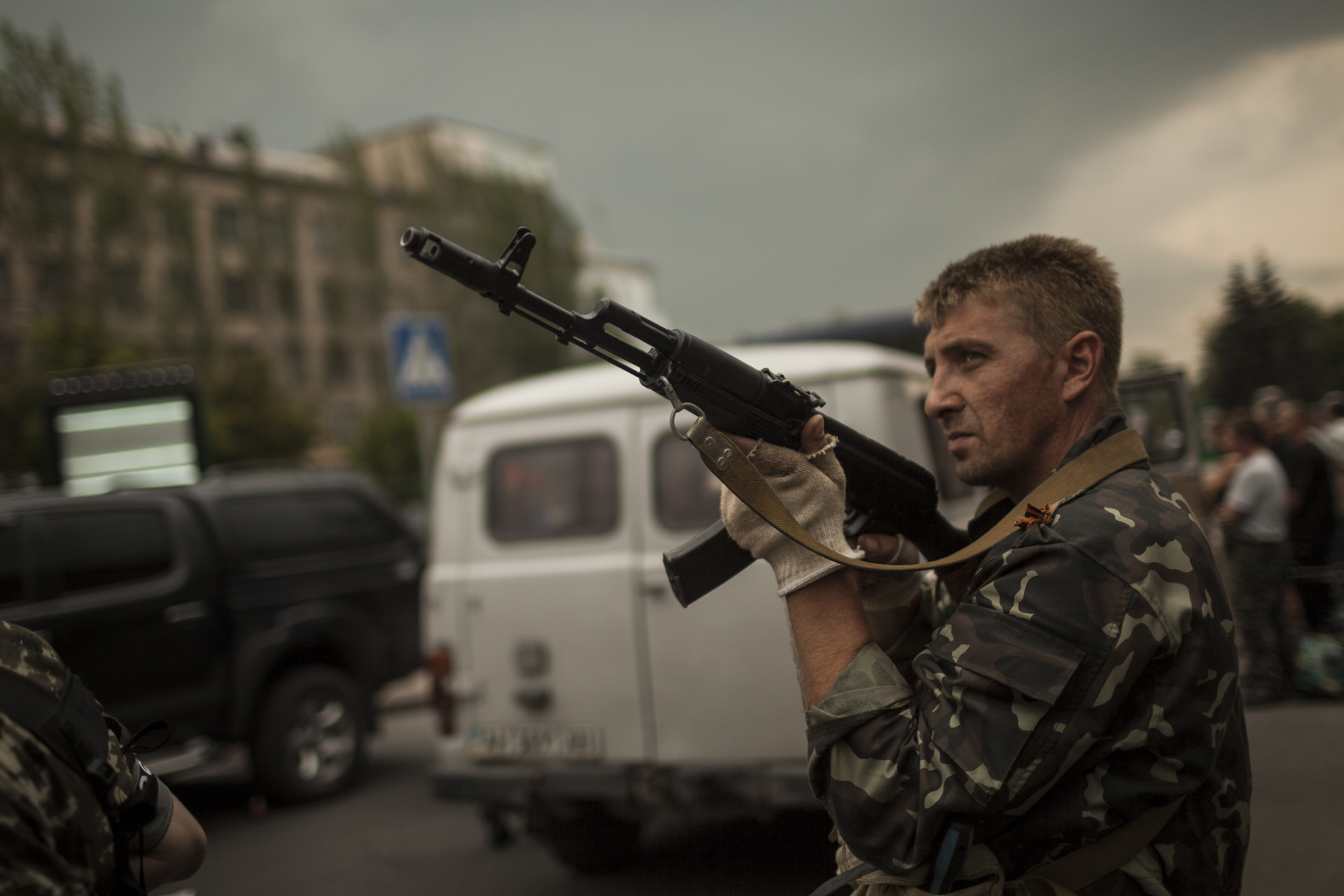 A militiamen aims his gun at the Rada during its violent takeover by the Vostok battalion on the 29th of May, following allegations of looting by activists of the Donetsk People's Republic.