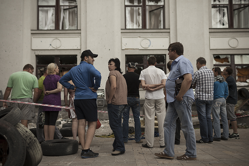 Citizens of Lugansk inspect the damage caused by a Ukrainian air strike on the local occupied building which killed three passersby on the 2nd of June.