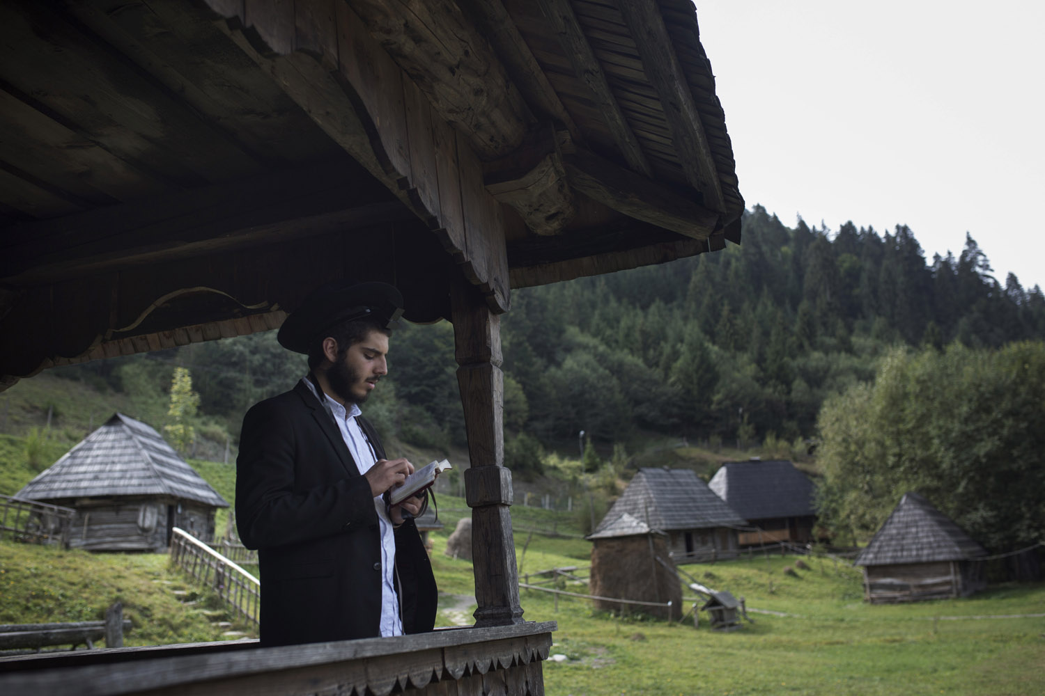 A religious Jew prays his morning prayer in Kolochava. He has been sent to help the local rabbi during holidays by Chabad, a Jewish religious organization whose mission is to bring Jews together and closer to God.