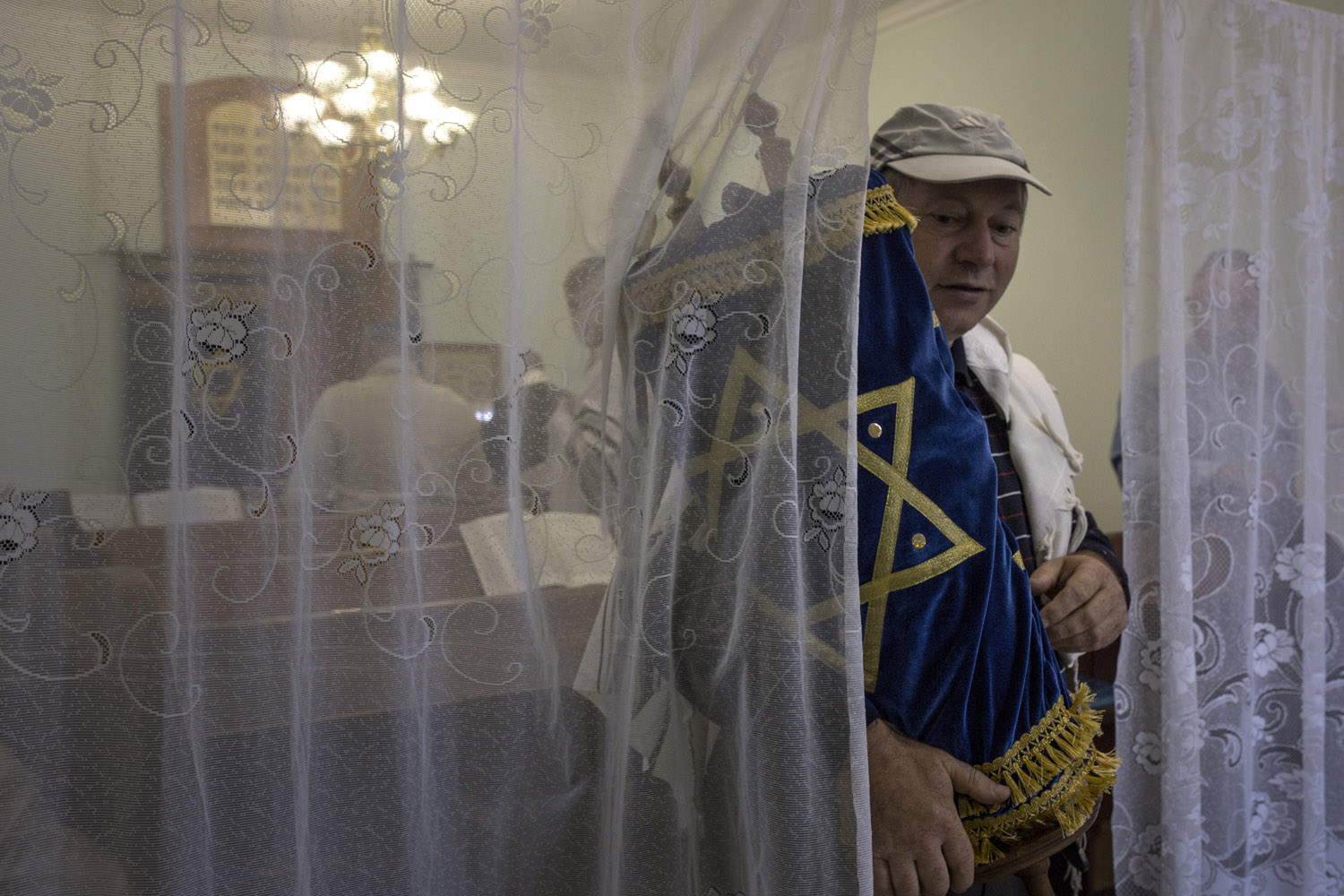 Vova, the president of the Jewish community of Khust, carries the Sefer Torah (Bible Scroll) during the shabbat prayers.