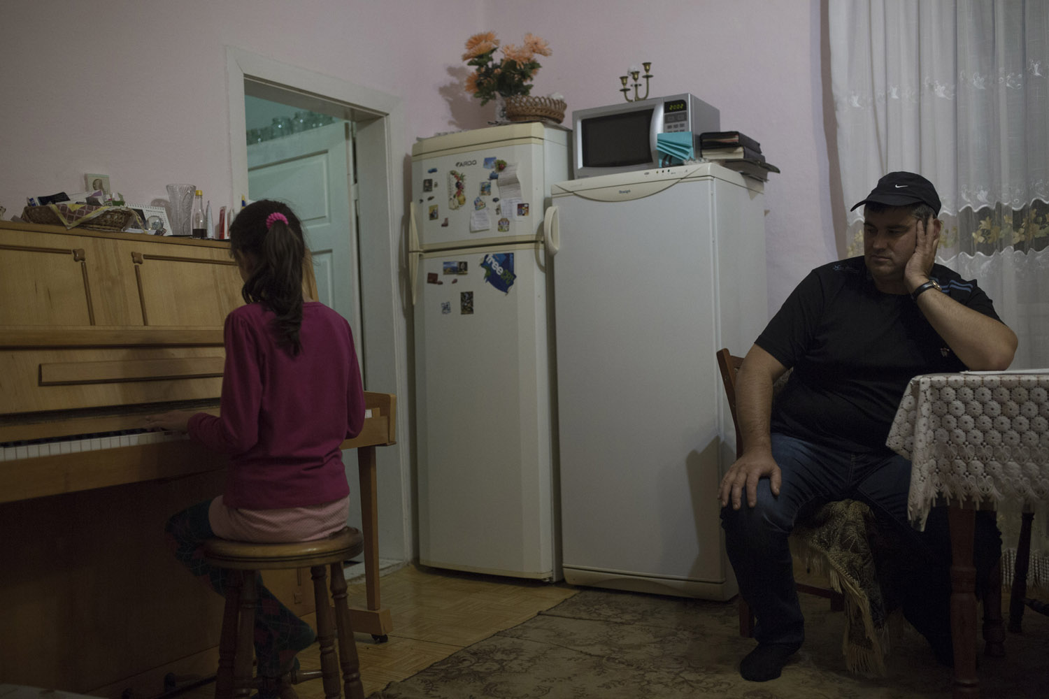 Vasily listens to his daughter Vera practising the piano in their home deep in the countryside near Khust. He only rediscovered his roots after neighbours told him that his grandparents were Jewish, and now tries to keep a kosher house, for example having two fridges, one for meat and one for milk products.