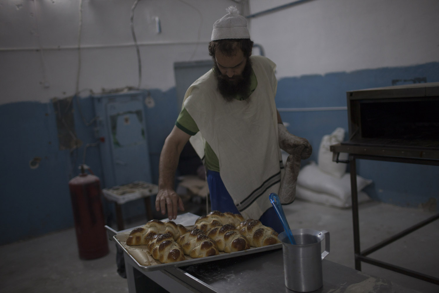 Aaron bakes challah in his Brooklyn Bakery in Uzhgorod. He grew up in a Jewish neighbourhood of New York and then moved here with his wife. He is fascinated by the region's Jewish heritage, and looks forward to showing his father that it is still possible to live a Jewish life here.