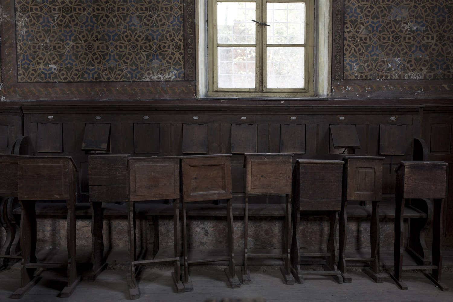 Empty prayer stalls in the synagogue of Khust. With great efforts, the community managed to restore the building and the interior is more or less intact, but there aren't enough Jews to fill it, so the Jews of Khust find it less depressing to use a smaller side room instead.