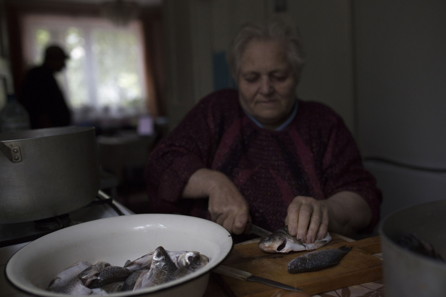 Vova's mother prepares gefilte fish, a traditional Jewish dish, at her home in Khust.