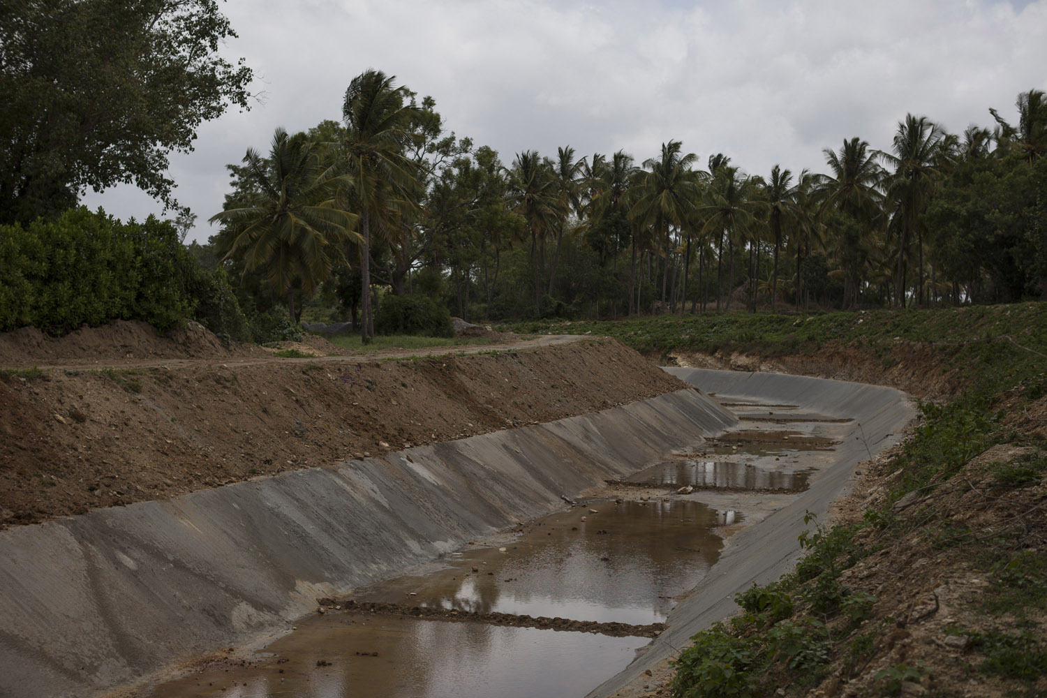 An irrigation channel from the Krishna Sagara Dam runs dry on a hot day in July, the middle of the rain season.
