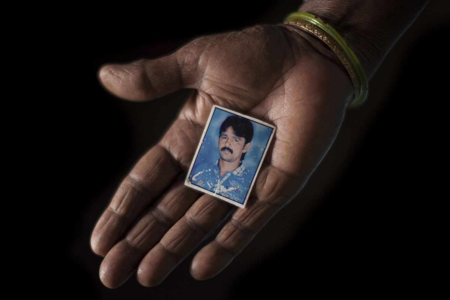"Shivanna (35), in a picture kept by his mother Savithriamma. ""He never touched any alcohol"", she remembers, ""yet that day he bought some at a shop. He probably needed it to do what he was planning to do."""