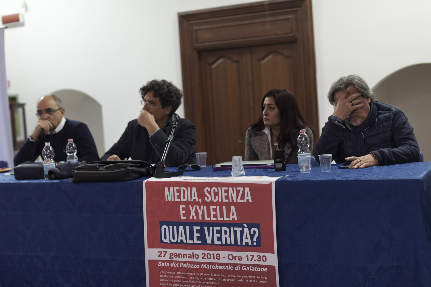 "A heated debate during a public meeting in Galatone titled ""Media, Science and Xylella. What is the truth?"", questioning the authorities' handling of the outbreak and the science that underlies it. Such meetings regularly degenerate as the different sides accuse each other of spreading ""fake news"" and putting the entire region in danger. (2018)"