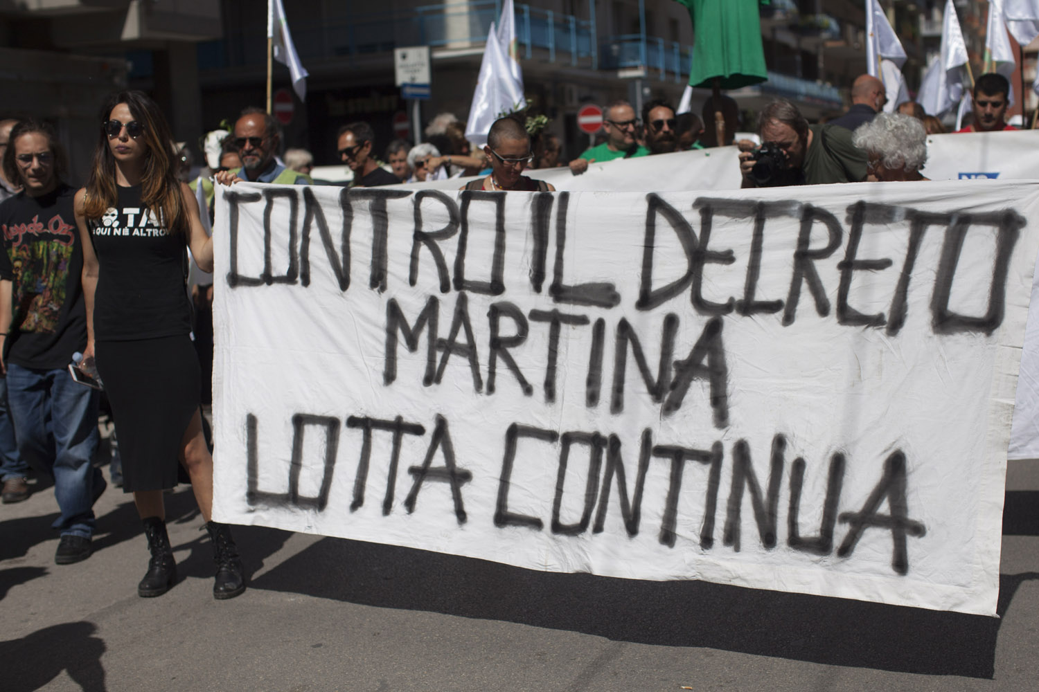 "A banner at a demonstration against the authorities' plans to contain the Xylella fastidosa outbreak announces an ""endless struggle"" against the ""Martina Decree"", the law that made the measures against the bacteria's carrier insect obligatory. (2018)"