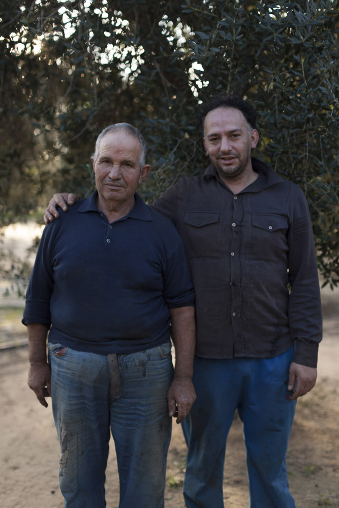 Mimmo and his father after a day of harvesting olives in the countryside of Cellino San Marco, in Salento. (2015)