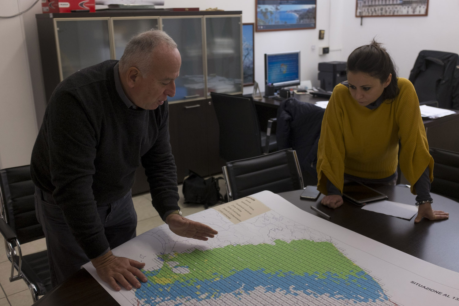 Discussing the plan to monitor the outbreak of Xylella fastidiosa in the offices of ARIF, Puglia's forestry agency, in Bari. Vast resources are being invested in monitoring the spread of the bacteria, which the European Union regards as a threat to all of agriculture that has to be contained at all costs because of its ability to evolve and adapt to a wide range of plants. (2016)