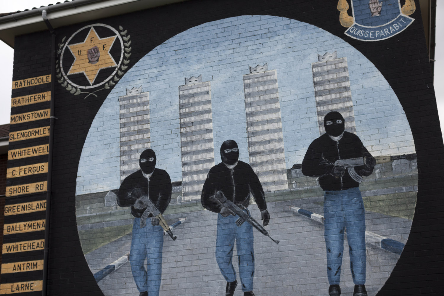 "A loyalist mural in Rathcoole, a working-class ""housing estate"" in North Belfast."