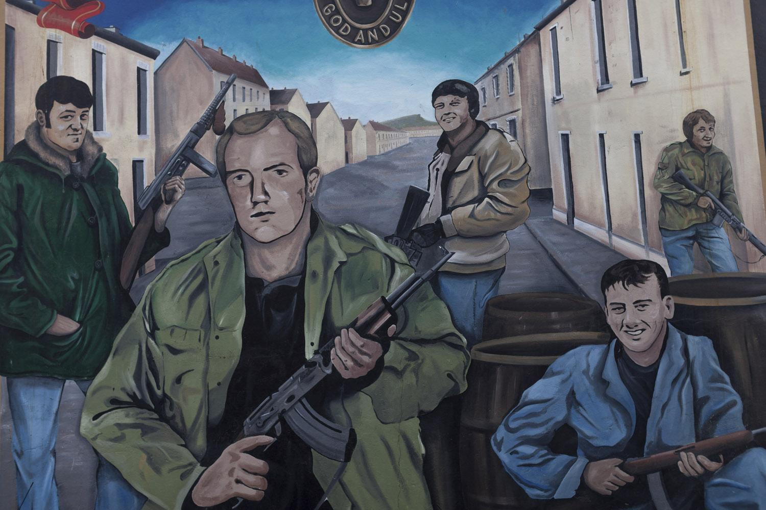 "A loyalist political mural in West Belfast. While Catholic murals are mostly about struggling for freedom, Protestant murals are mostly about defending the community from external attacks, with loyalist paramilitaries depicted as ordinary citizens forced to take up weapons in the face of the threat posed by Irish terrorism. In their opinion, Irish reunification would result in Protestants ""being thrown to the sea"", more than three centuries after they came to Ireland as part of the English colonization of the island."